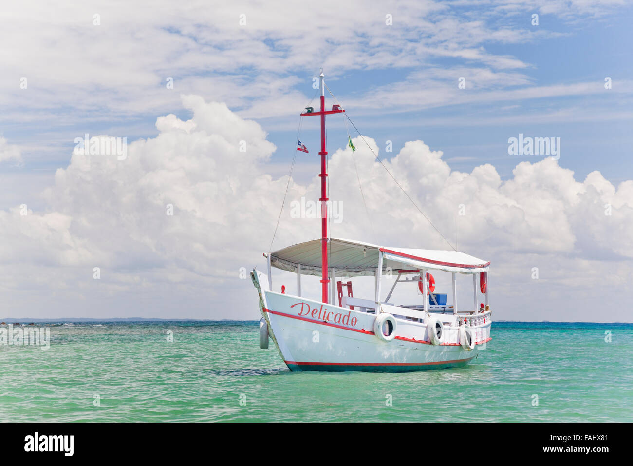 The 'Delicado' at anchor near Morro de São Paulo, in Brazil's northern state of Bahia. - Stock Image