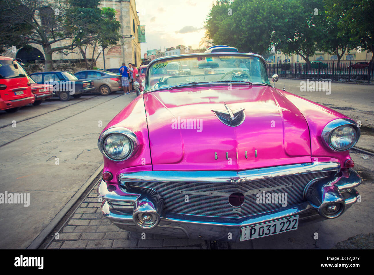 HAVANA, CUBA - 4 DEC, 2015. Pink vintage classic American car, commonly used as private taxi parked in Havana street. Stock Photo
