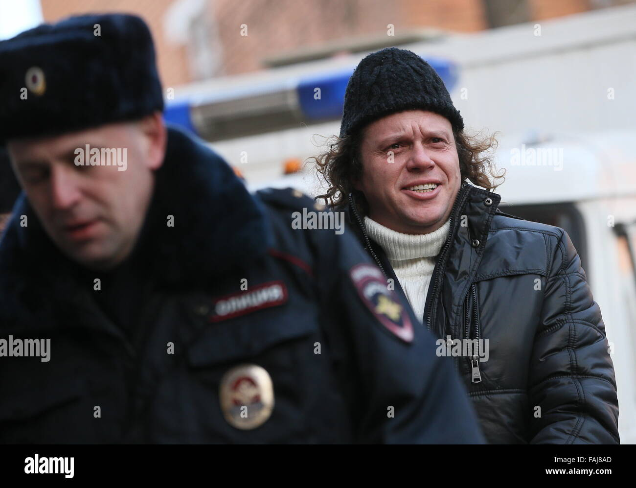 Moscow, Russia. 29th Dec, 2015. Russian tycoon Sergei Polonsky (R), charged with large scale fraud, seen ahead of - Stock Image