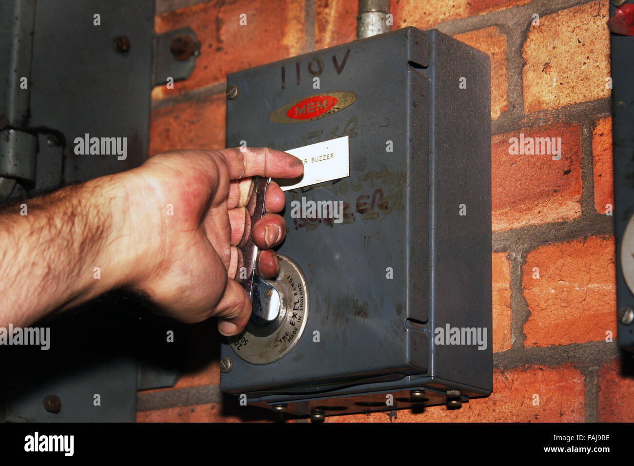 About to operate electrical isolation switch. - Stock Image