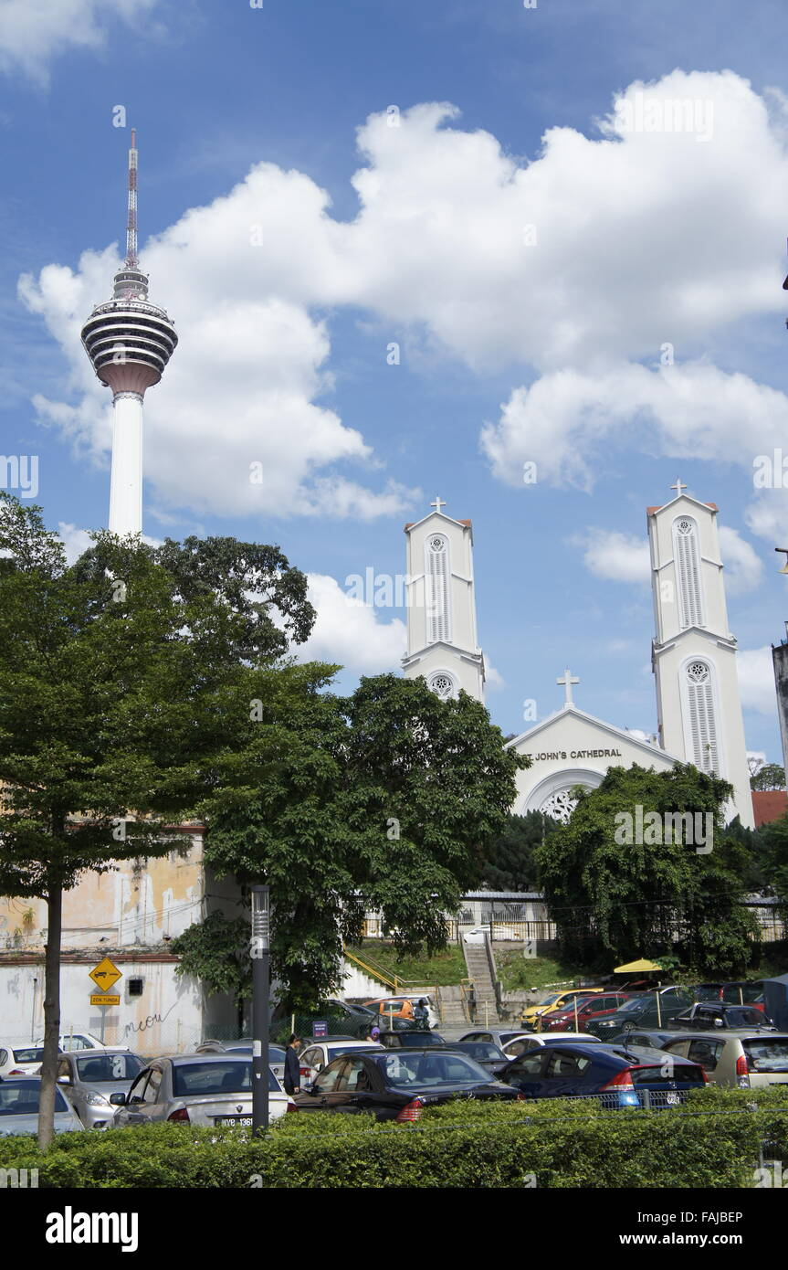 St John cathedral in Kuala Lumpur, Malaysia with KL Tower nearby. Modern multiracial multireligious country - Stock Image