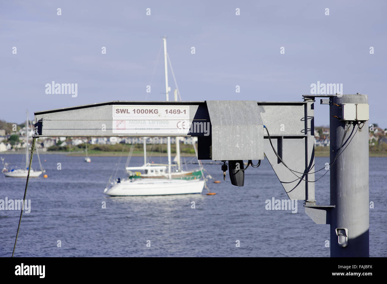 Boat lift with out of focus yacht in backgroundharbour Stock