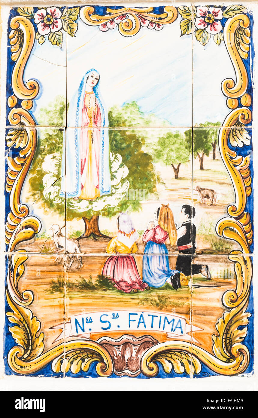 traditional azulejo technique tile painting showing the apparition of virgin mary apparently experienced by three Stock Photo