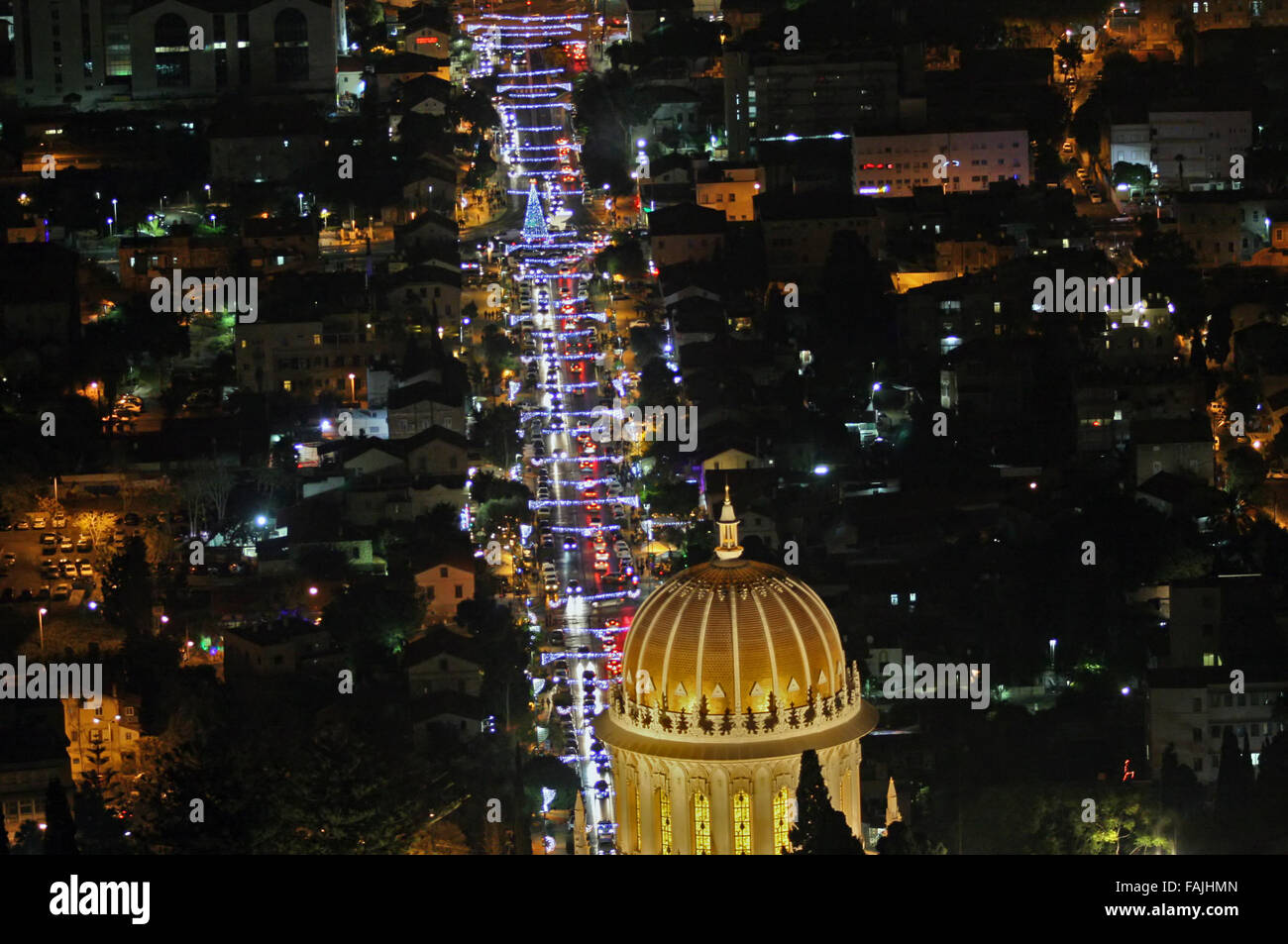 Israel, Haifa, The city is lit up with Christmas decorations Photogrphaed December 17th 2015 The Bahai temple in - Stock Image
