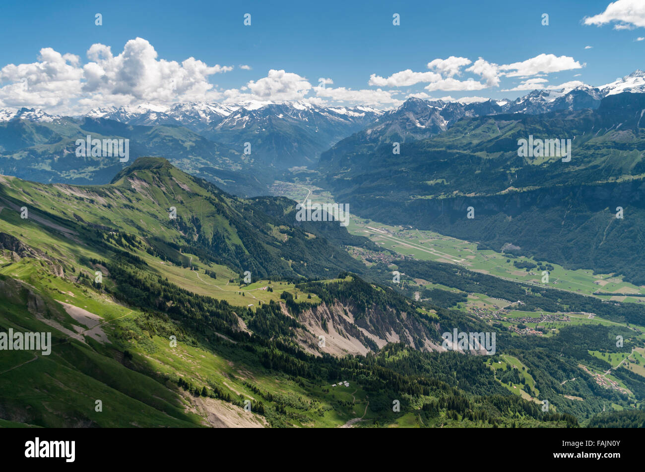 View of Haslital valley, Meiringen Airport, and the Alps. Berner Oberland, Switzerland. Picture taken from the summit - Stock Image