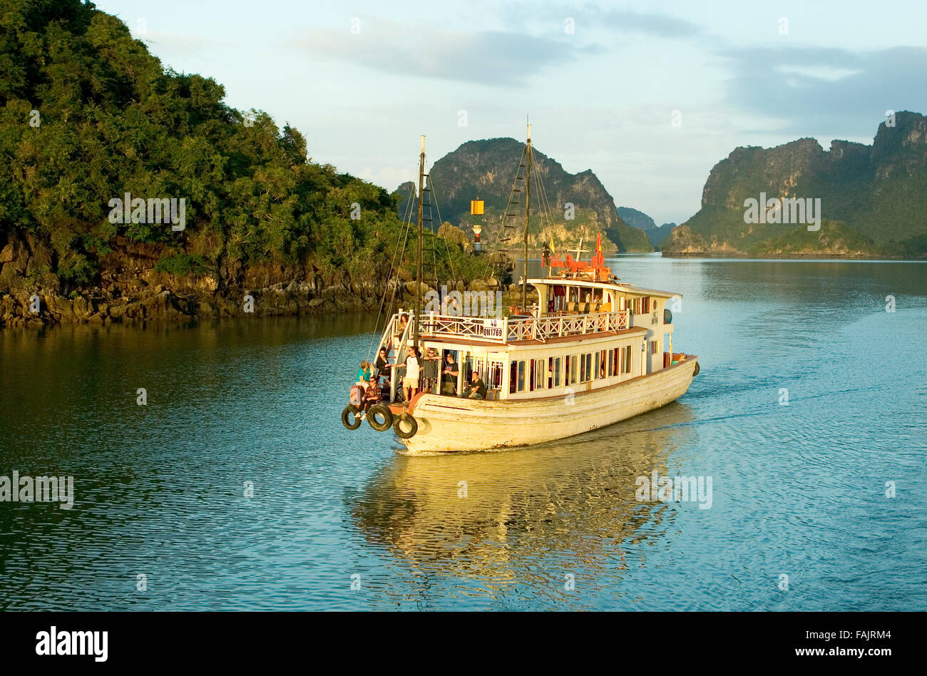 Tourist boat and limestone karst in Ha long, Halong Bay, Vietnam, Ha long, Halong Bay, Vietnam - Stock Image