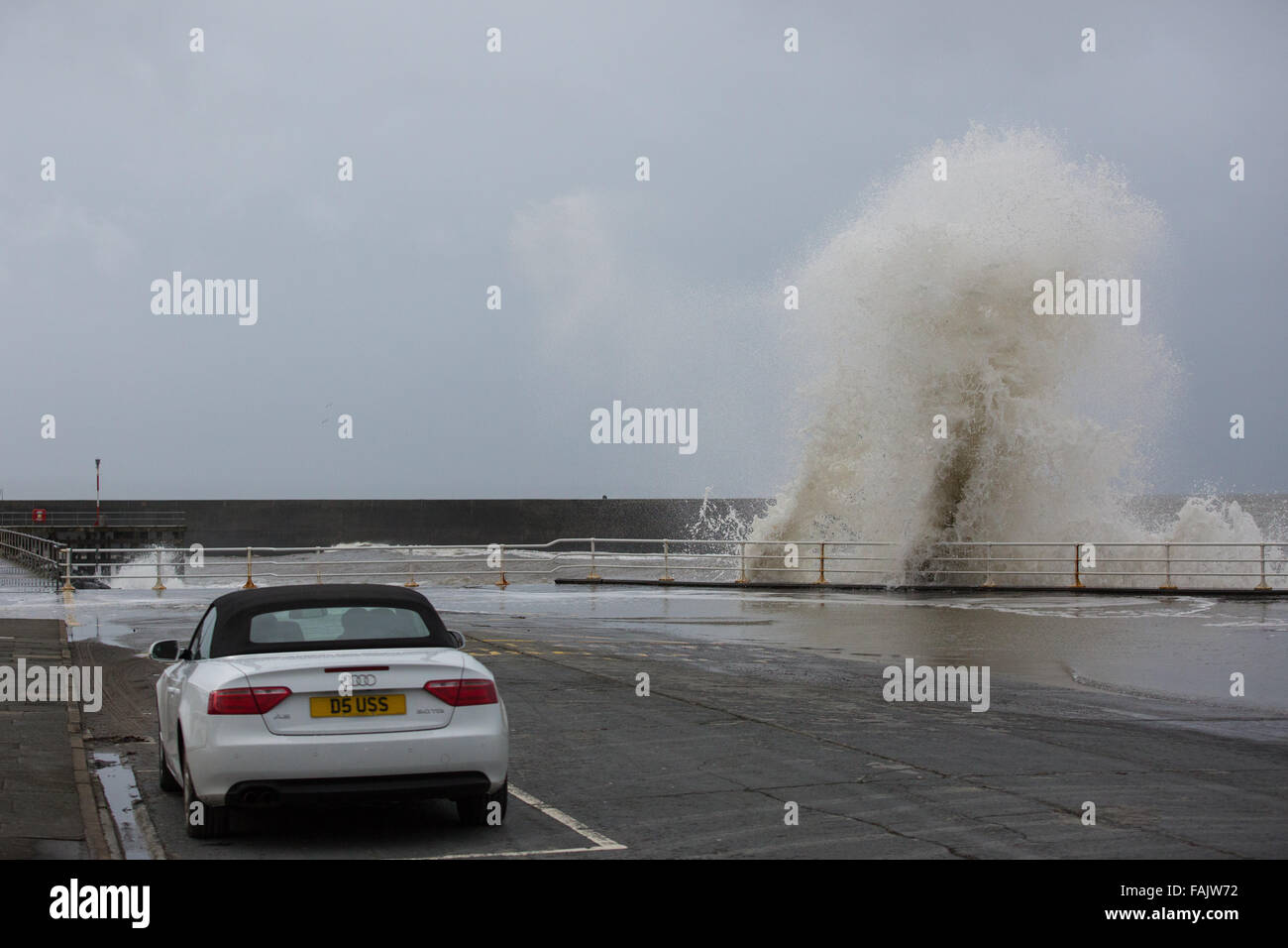 Aberystwyth, Wales, UK. 31 December 2015. New Year's Eve. . 'Wave goodbye to 2015'. As the remnants - Stock Image