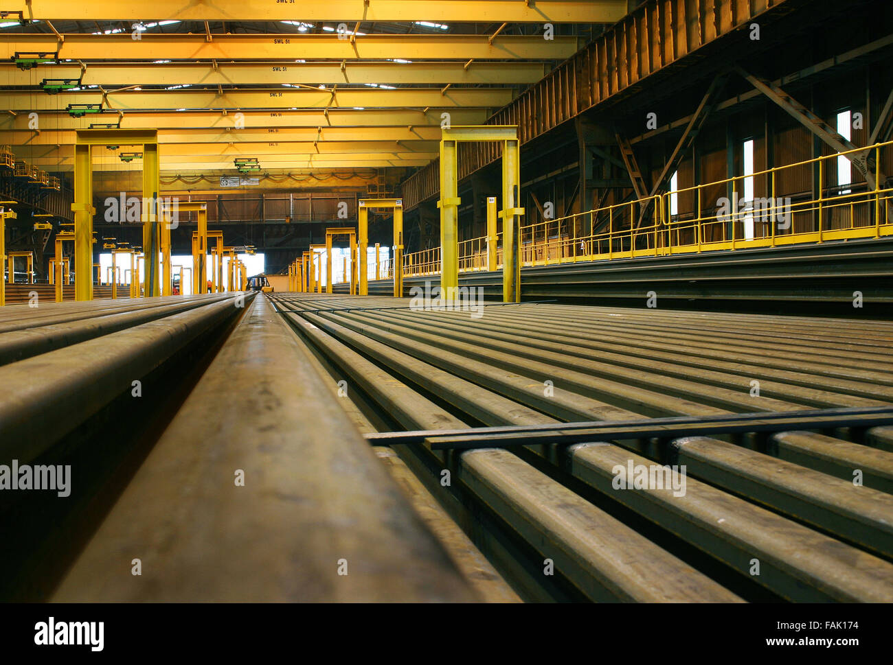 Long lengths of rolled steel railway track. - Stock Image