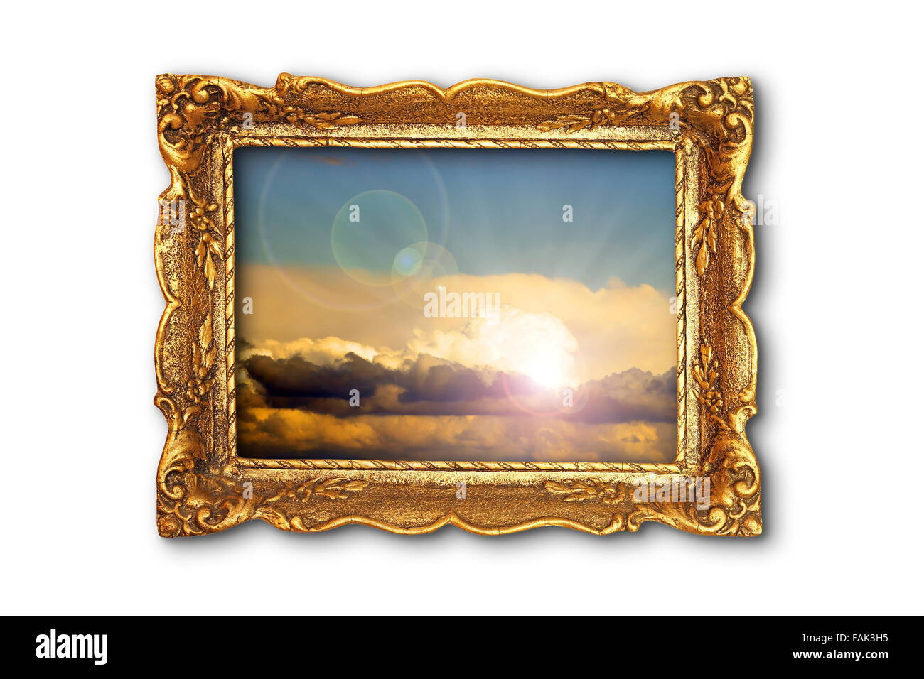 colorful sky image in ancient gilded painting frame; the image with the cloudy sky I used is also one of my pictures, - Stock Image