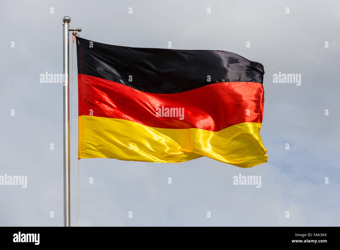 German Flag waving in the wind - Stock Image