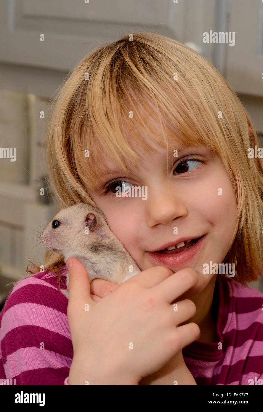 Girl, six years old, with a hamster, Ystad, Scania, Sweden Stock Photo