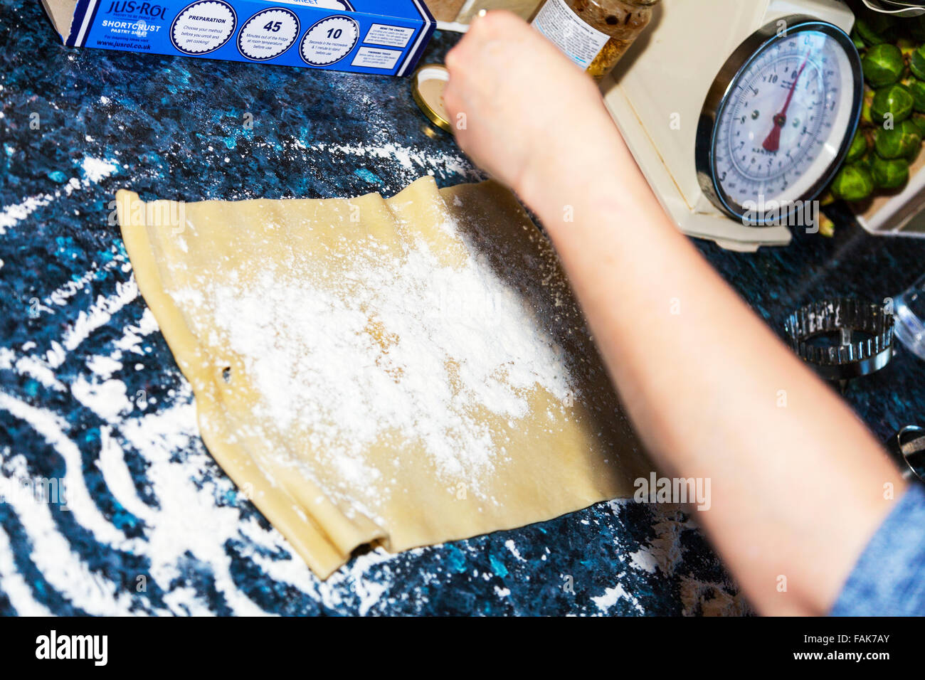 Pastry rolled out sheet ready for cutting flower flowering kitchen worktop cooking baking just roll in a box - Stock Image