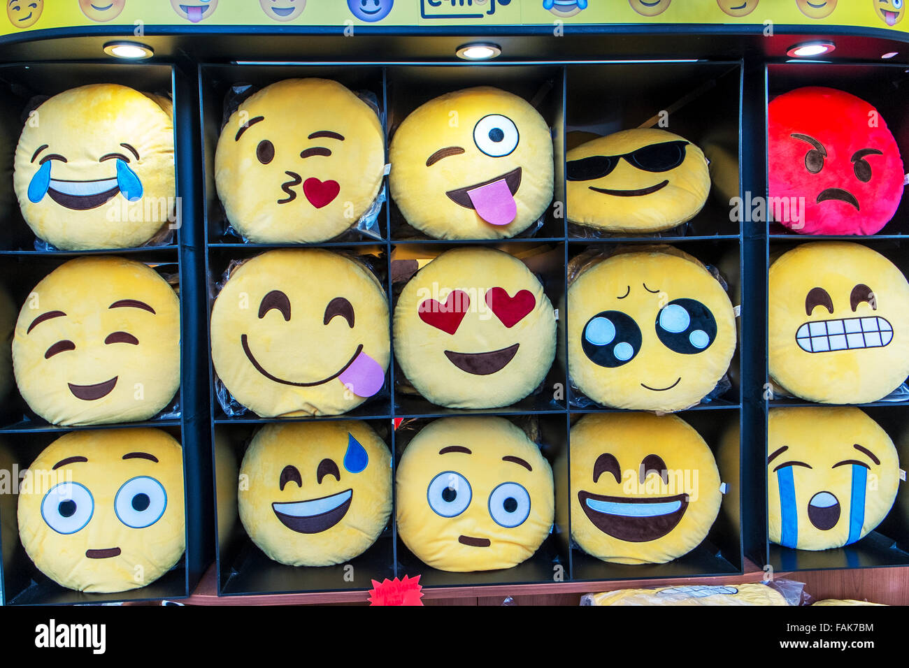 Emoji Emojis emoticon teen language smilies happy sad cheeky angry face faces phone gestures text texting shorthand - Stock Image
