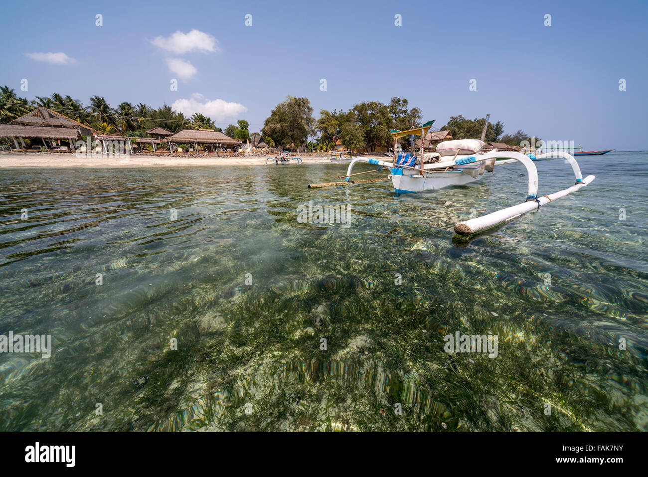 outrigger canoe at the beach on the small island Gili Air, Lombok, Indonesia, Asia - Stock Image