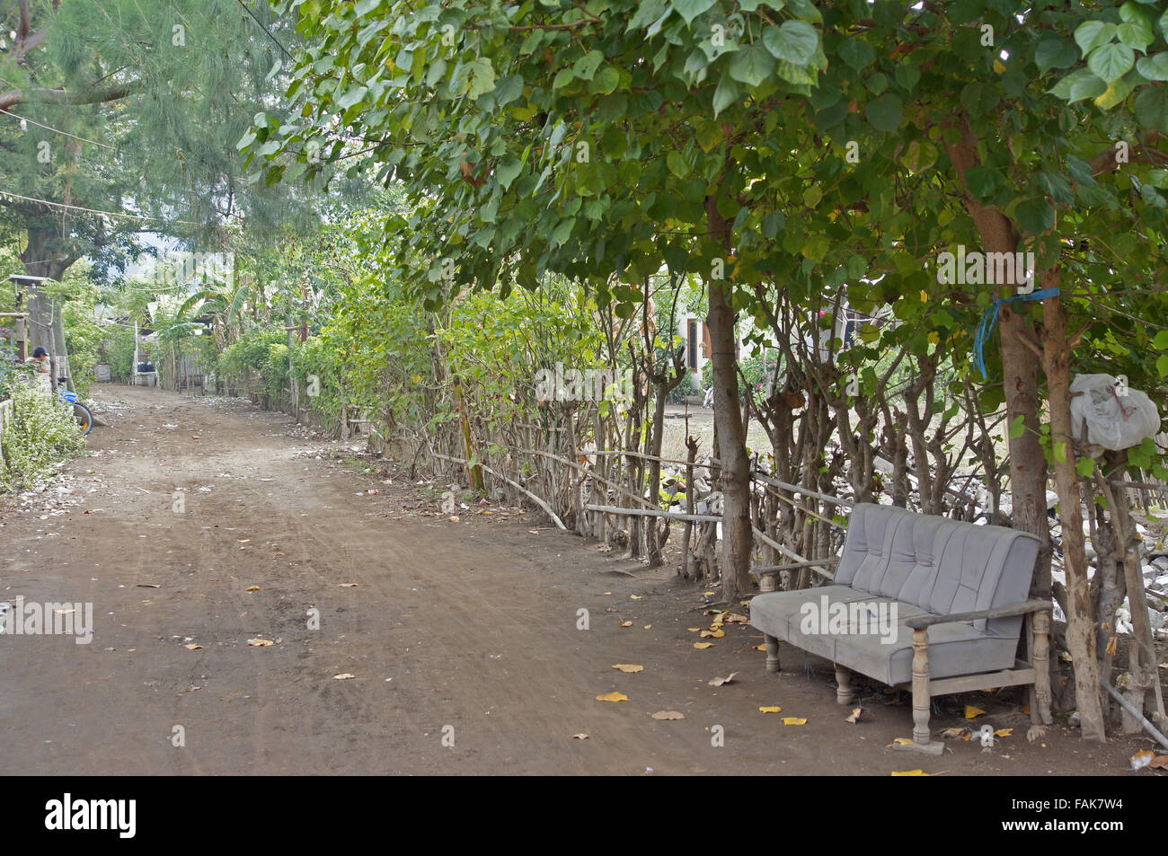 Sofa on the street on a still undeveloped Gili Islands, Indonesia - Stock Image