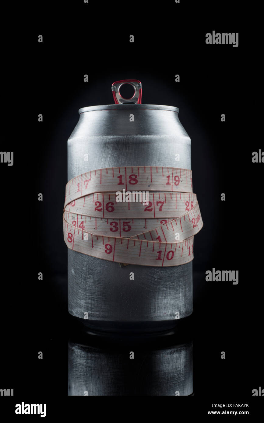 can of cola drink with tape measure, concept. - Stock Image