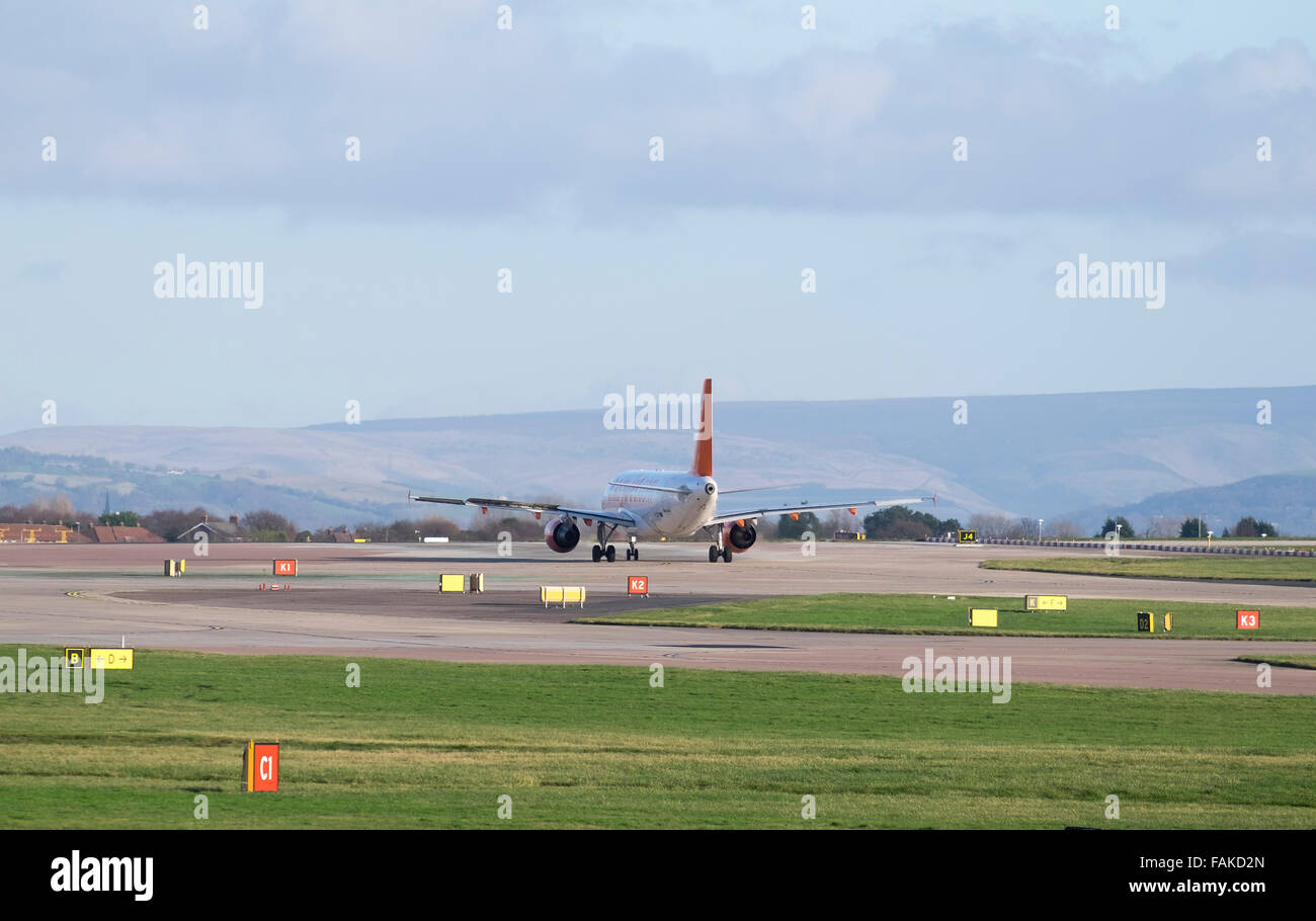 Passenger Plane prepares for take off at manchester Airport. Uk - Stock Image