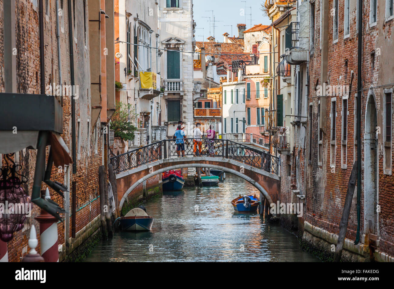 Venetian buildings and boats along Canal Grande, Venice, italy - Stock Image