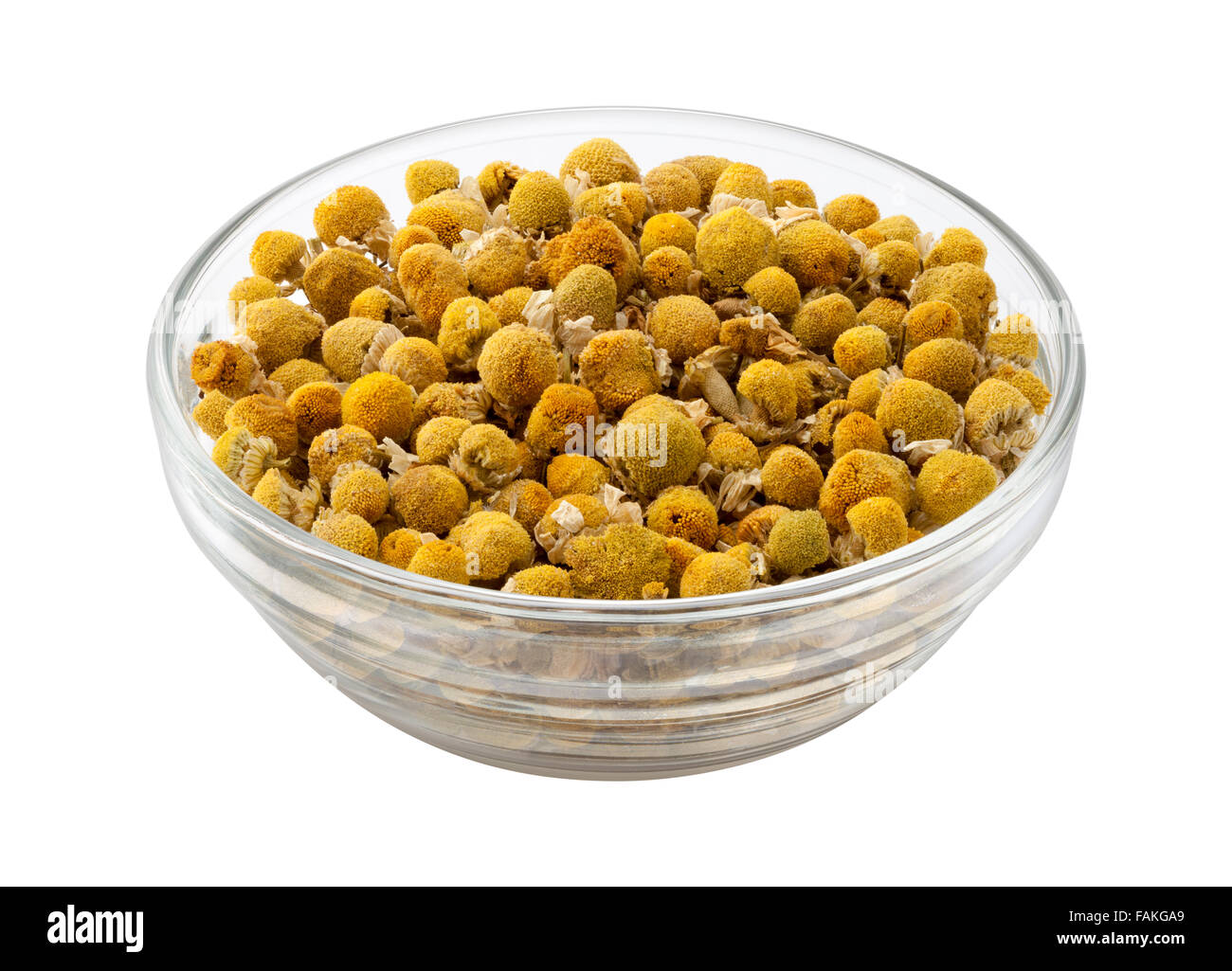 Loose Leaf Chamomile in a Glass Bowl - Stock Image
