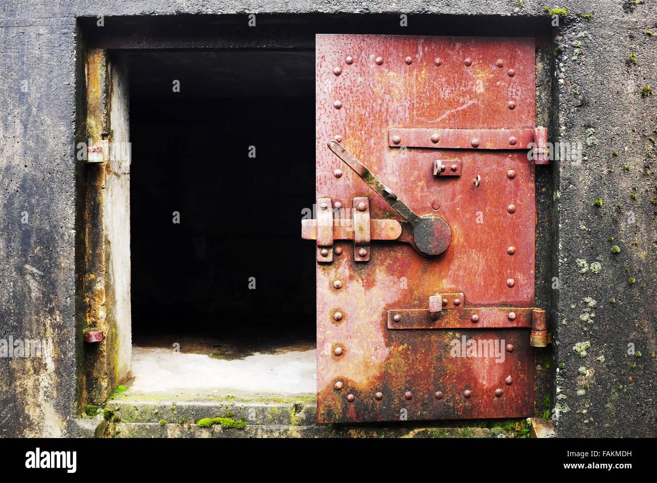 Open rusty red steel door in concrete bunker window Artillery Hill Fort Worden State Park Port Townsend Washington USA & Open rusty red steel door in concrete bunker window Artillery Hill ...