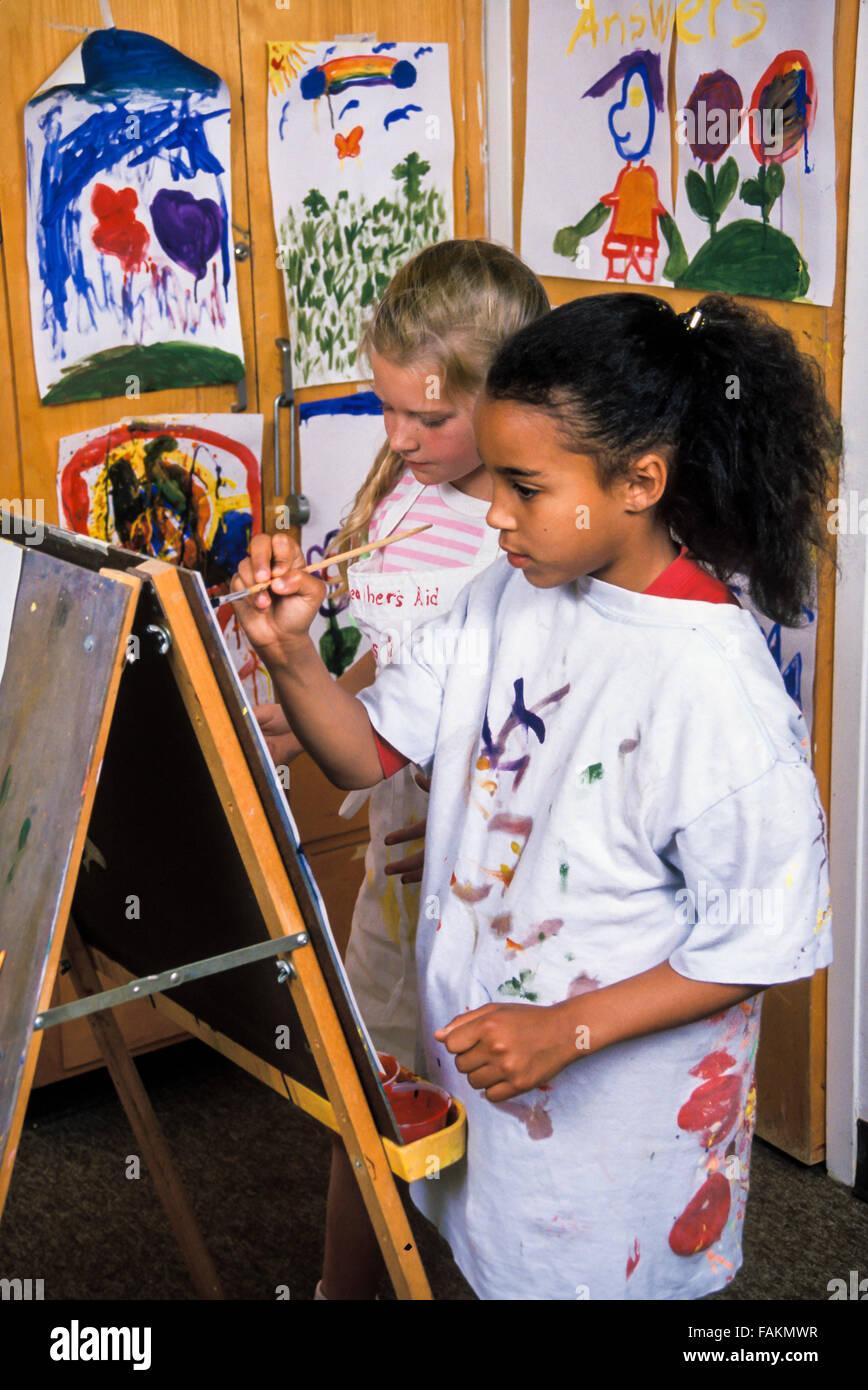 Child's drawing painting class art class diversity racially diverse multi interracial inter racial kids MR © - Stock Image