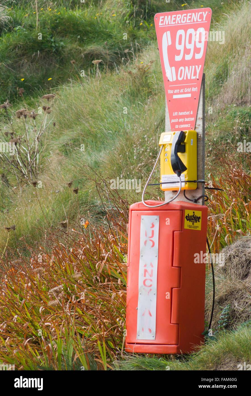 Emergency 999 Telephone in a Coastal Setting, Cornwall, England, UK - Stock Image