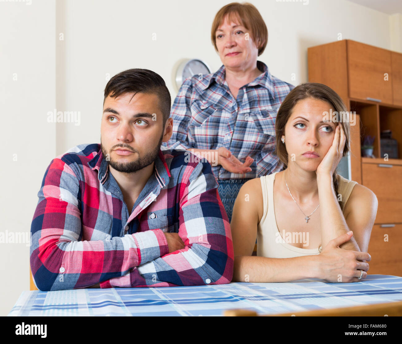Young family has a  stressful conversation with there mother - Stock Image