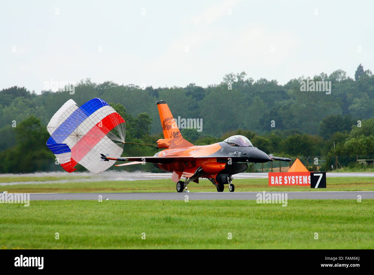 A Dutch F16 J-015 landing at the Royal International Air Tattoo RIAT 2012 at Fairford with the parachute open - Stock Image