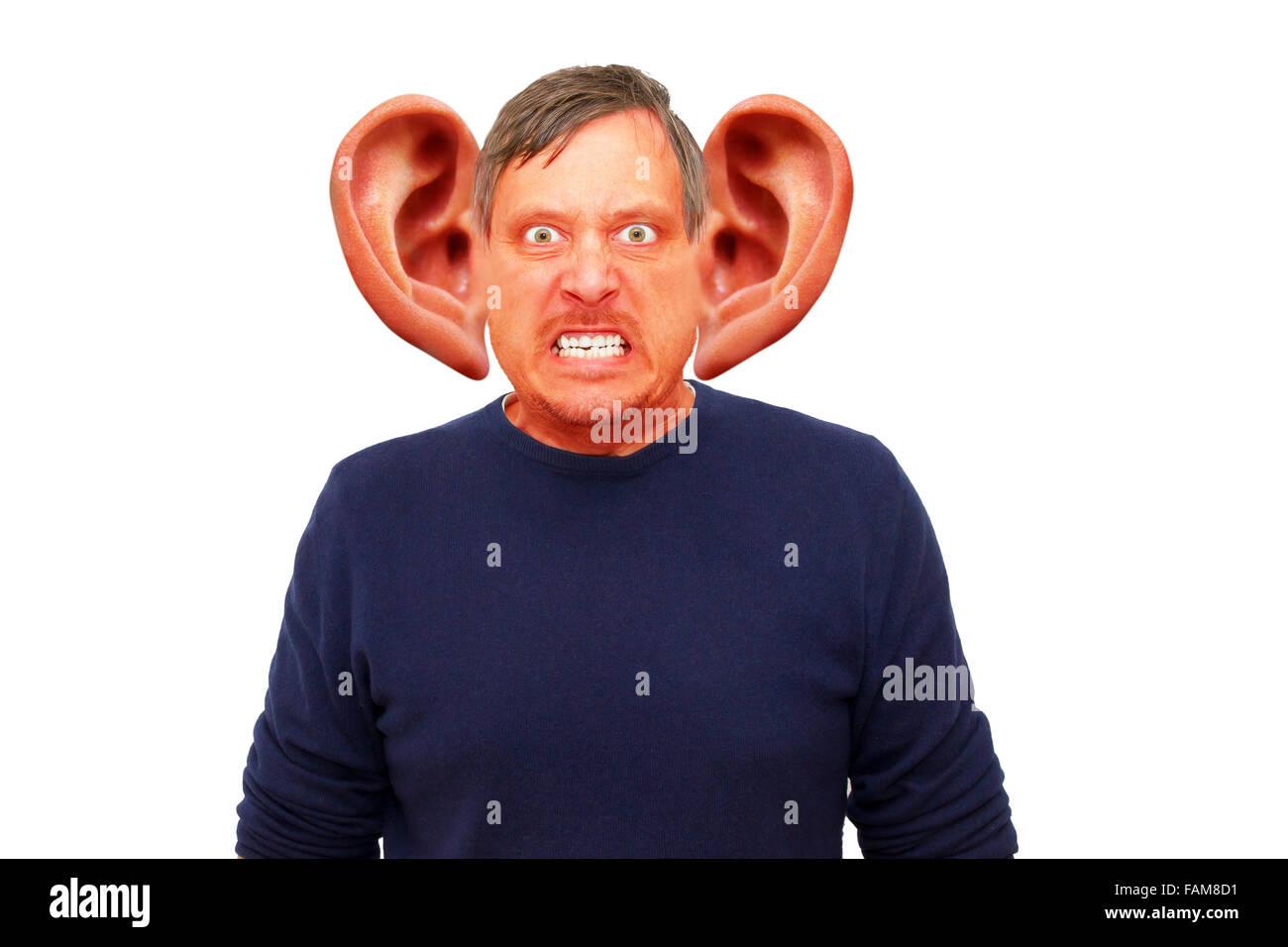Angry man with funny big ears - Stock Image