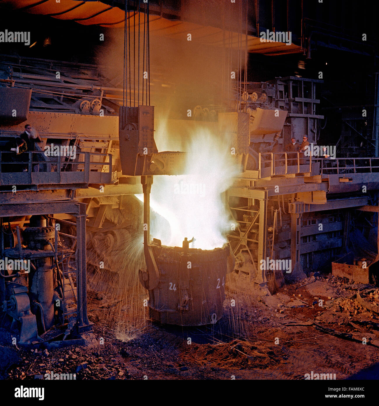 Tapping old style open hearth steel furnace. - Stock Image