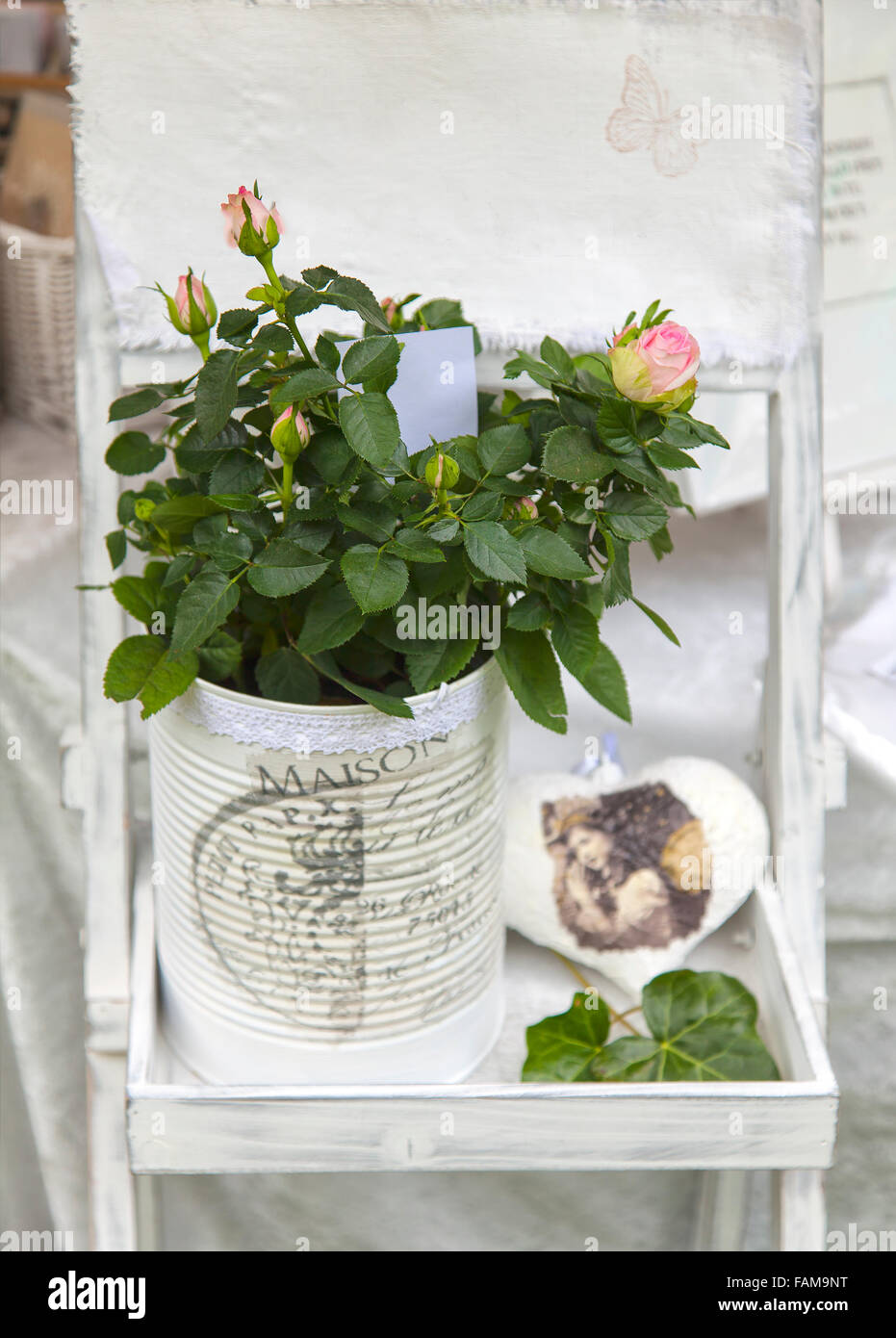 Image of romantic shabby chic flower arrangement. - Stock Image