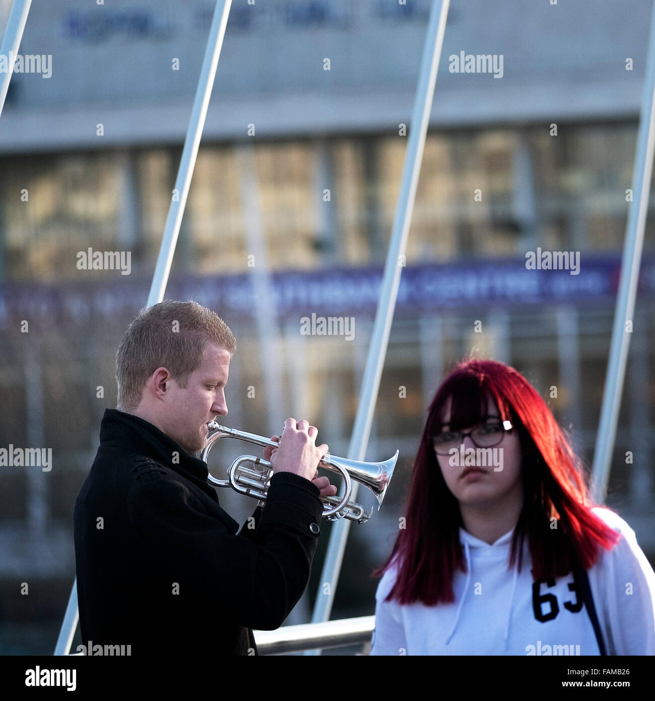 A busker plays the cornet in London. - Stock Image