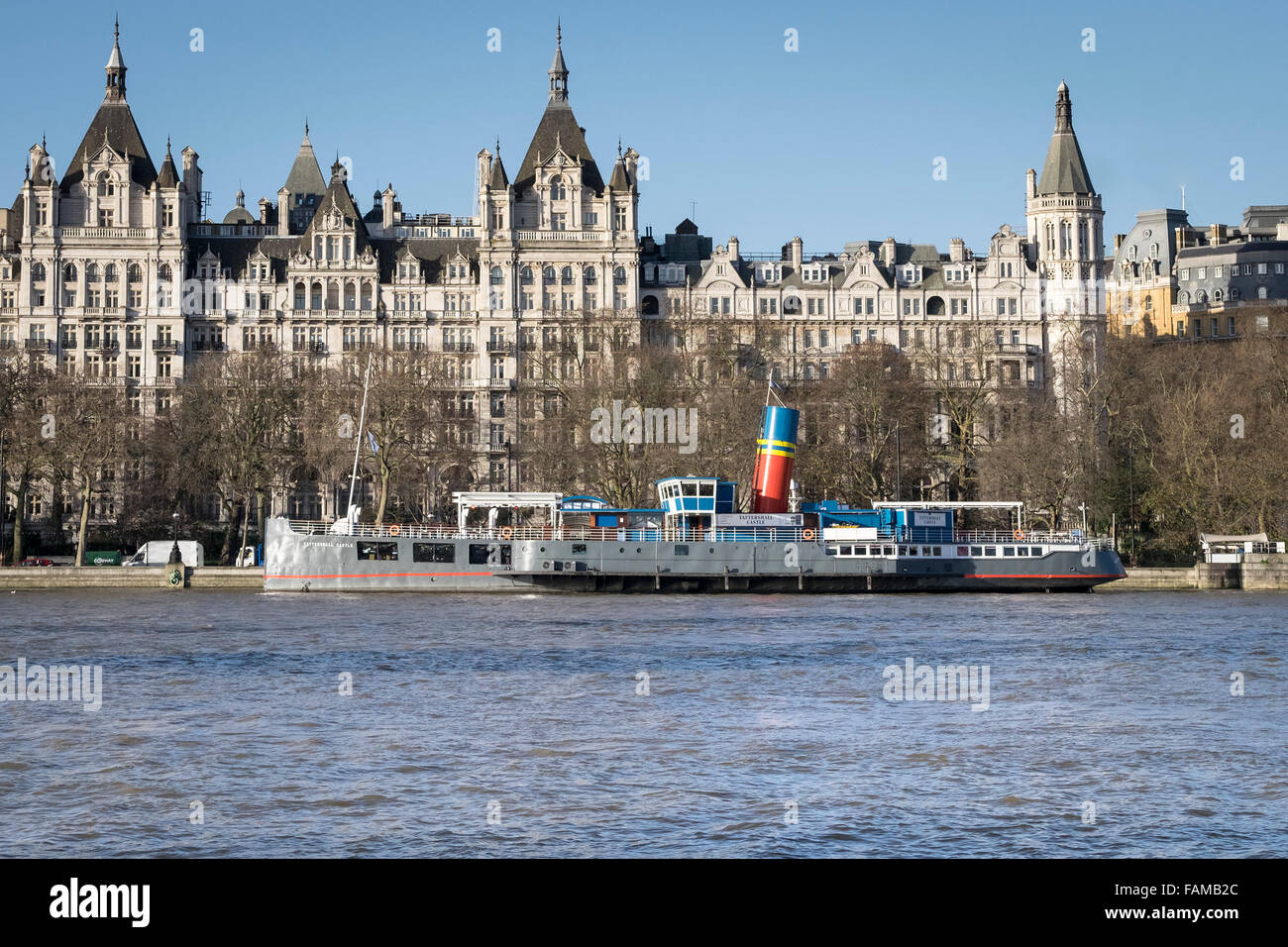 The Tattershall Castle moored in front of Whitehall Court on the Embankment in London. - Stock Image