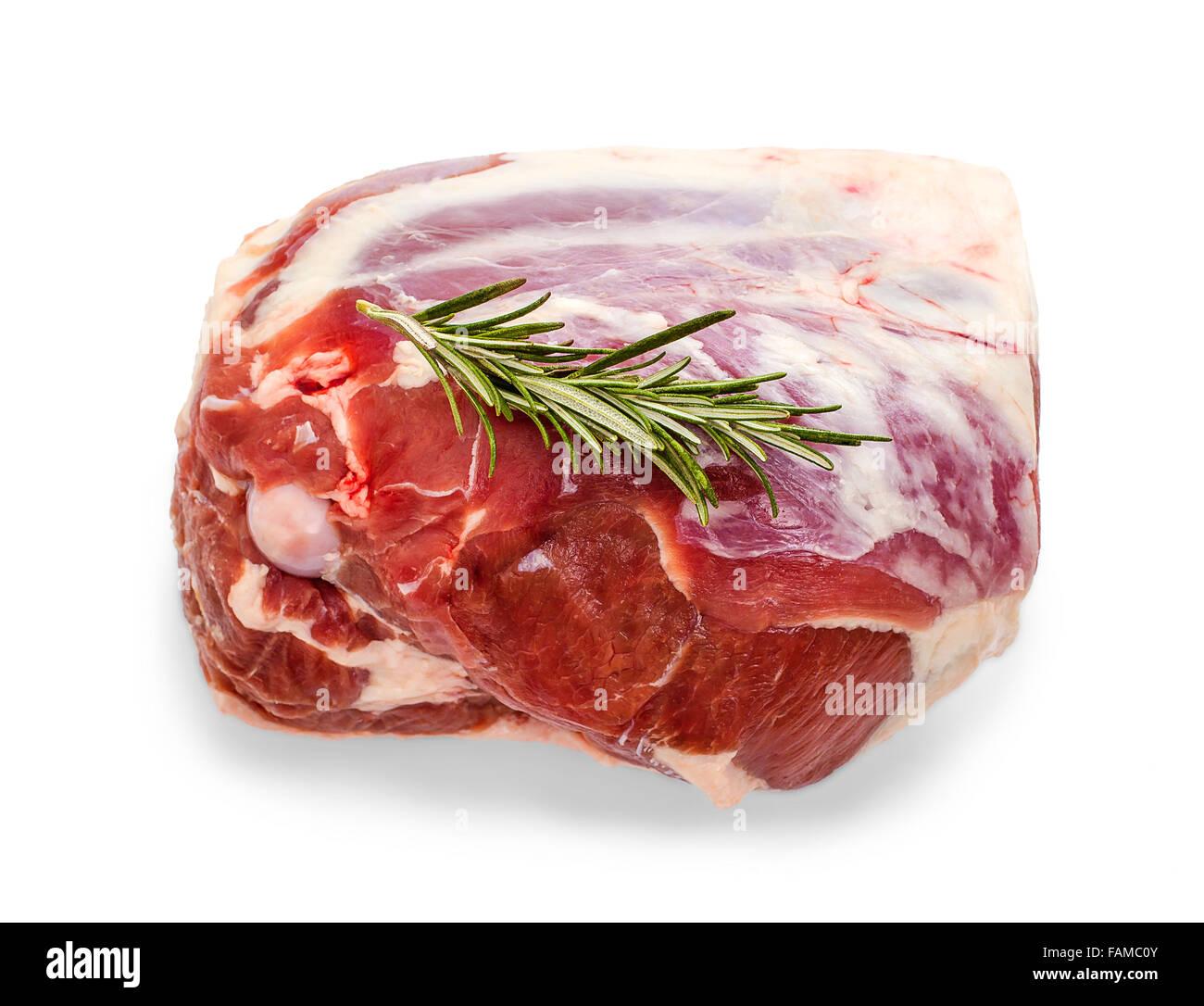 Frozen lamb leg with rosemary twig isolated on white - Stock Image