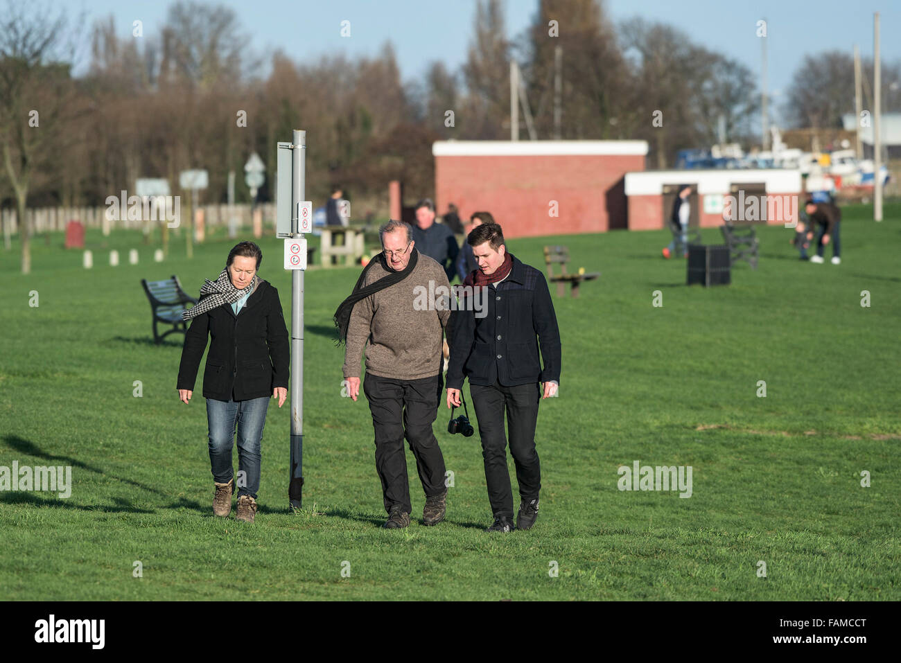 People walking in the park near East Beach in Shoeburyness, Essex, UK. - Stock Image