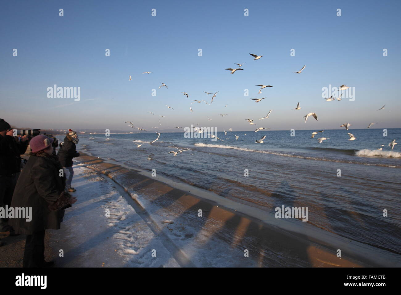 Gdansk, Poland 1st. Jan. 2015 People enjoy very cold (-5 Celsius degrees) but sunny weather walking along the Baltic - Stock Image