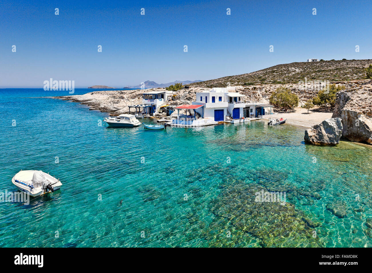 "Traditional fishermen houses with the impressive boat shelters, also known as ""syrmata"" in Mytakas of Milos, Greece - Stock Image"