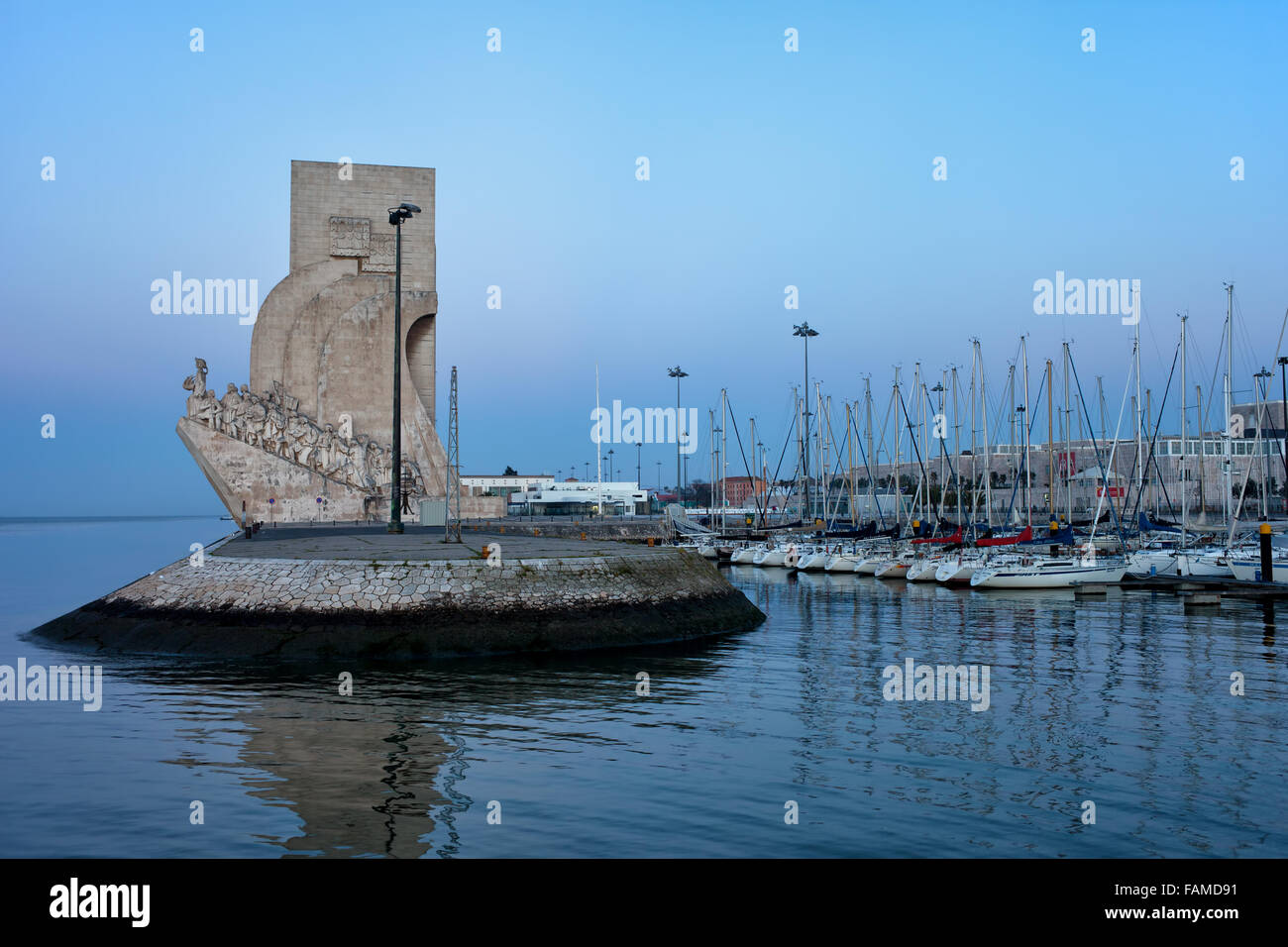 Monument to the Discoveries (Padrao dos Descobrimentos) and Doca De Belem marina in Lisbon, Portugal in the morning - Stock Image