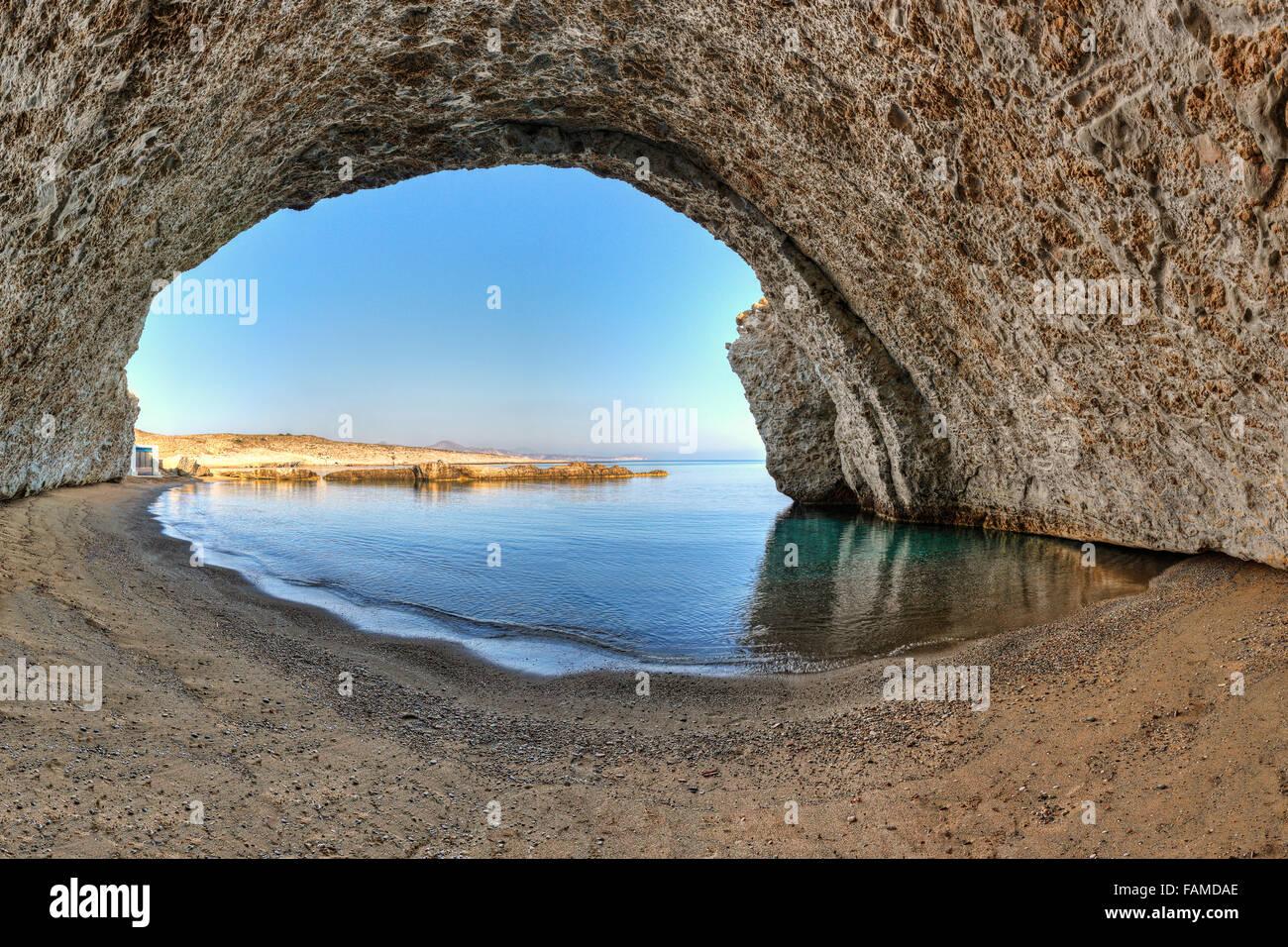 The beach Alogomandra inside a cave in Milos, Greece - Stock Image