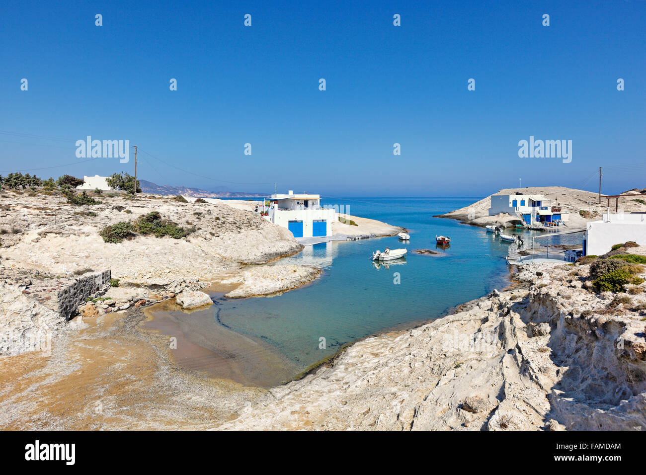 """Traditional fishermen houses with the impressive boat shelters, also known as """"syrmata"""" in Agios Konstantinos of - Stock Image"""