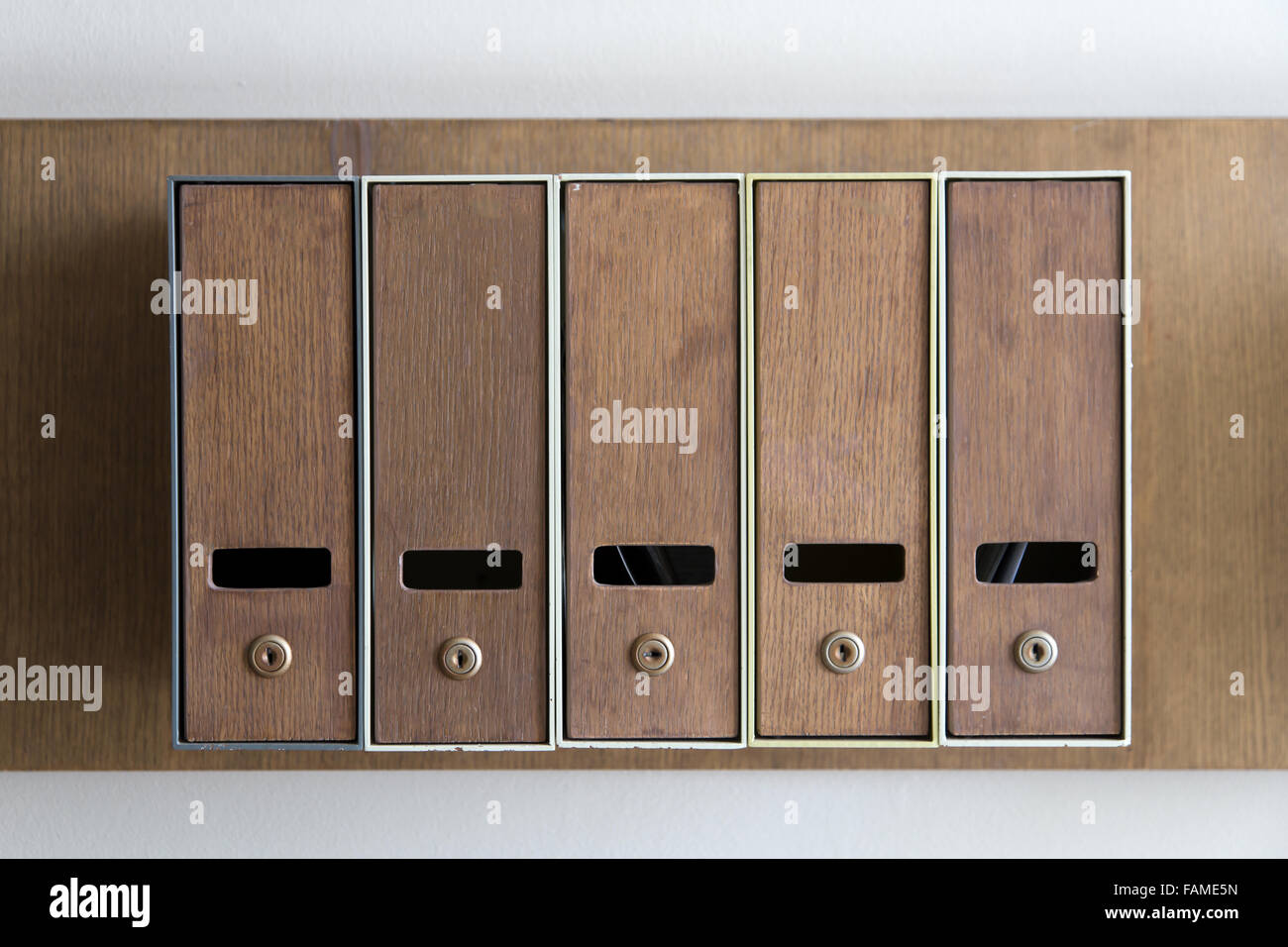 Five mailboxes are attached in the same group on the wall - Stock Image