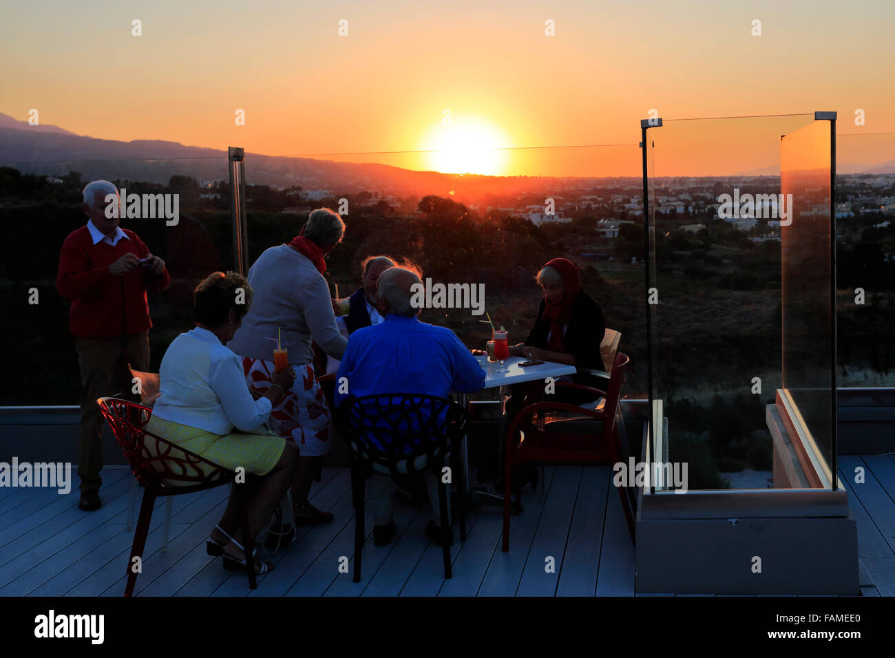Sunset, Red Loft Rooftop Bar, Kipriotis Panorama Hotel, Kos Town, Kos Island, Dodecanese group of islands, South - Stock Image