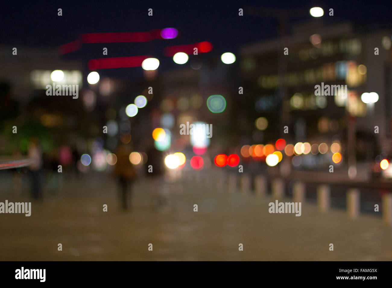 Defocused urban abstract texture ,bokeh of city lights in the background with blurring lights for your design - Stock Image