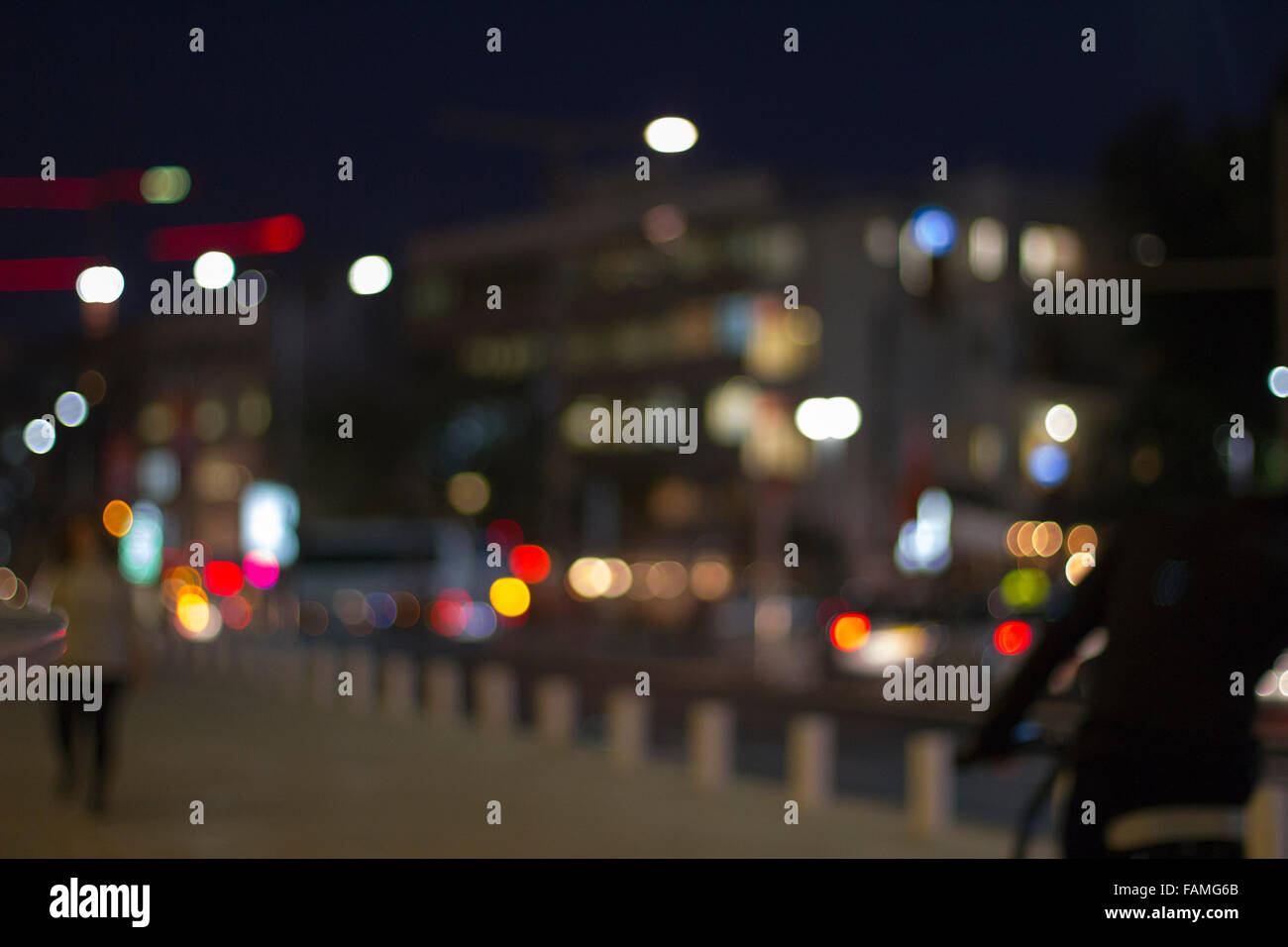 Defocused urban abstract texture ,boke of city lights in the background with blurring lights for your design - Stock Image
