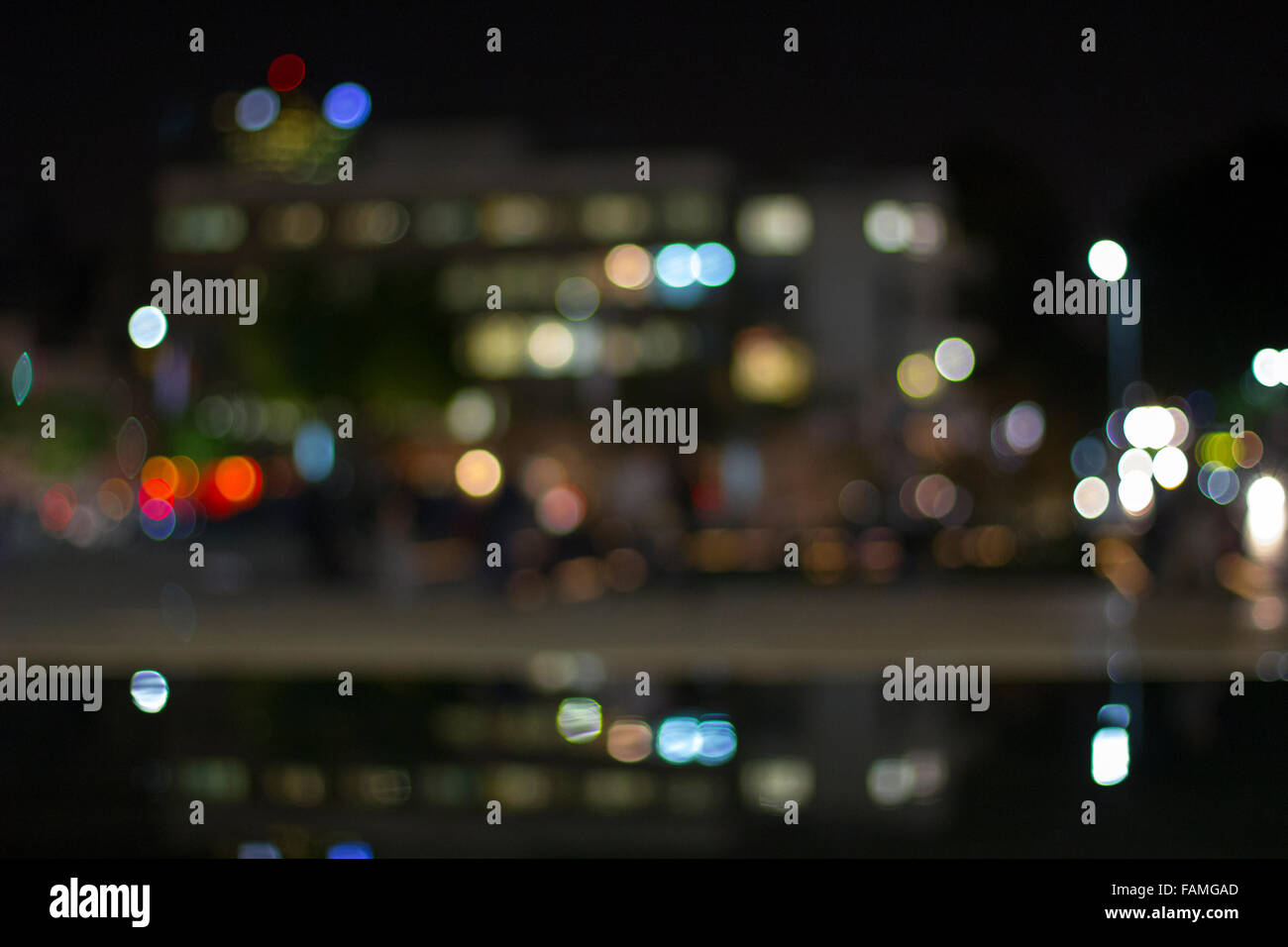Artistic style - Defocused urban abstract texture,city lights boke in the background with blurring lights and water Stock Photo