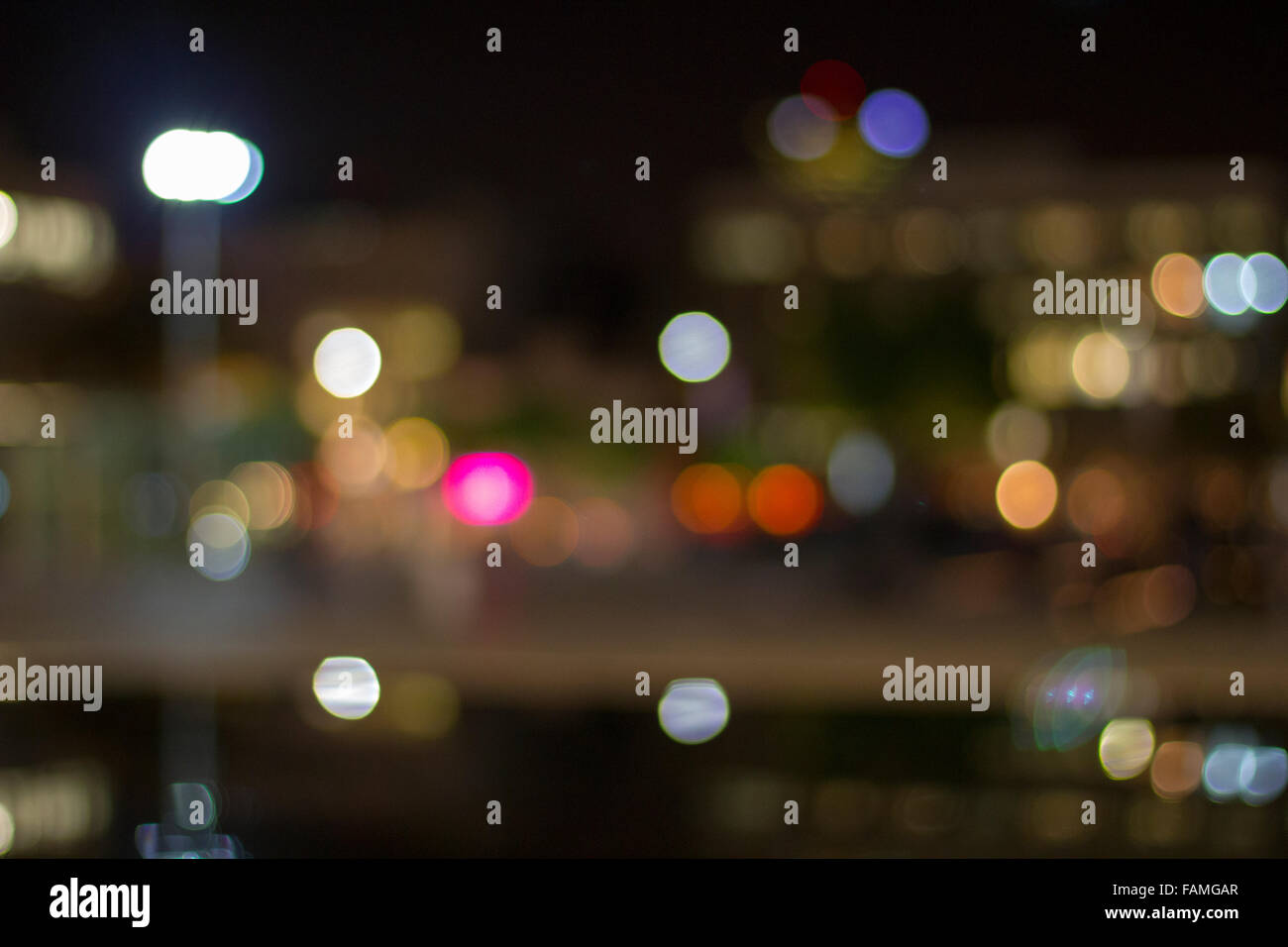 Artistic style - Defocused urban abstract texture ,bokeh of city lights in the background with blurring lights for - Stock Image