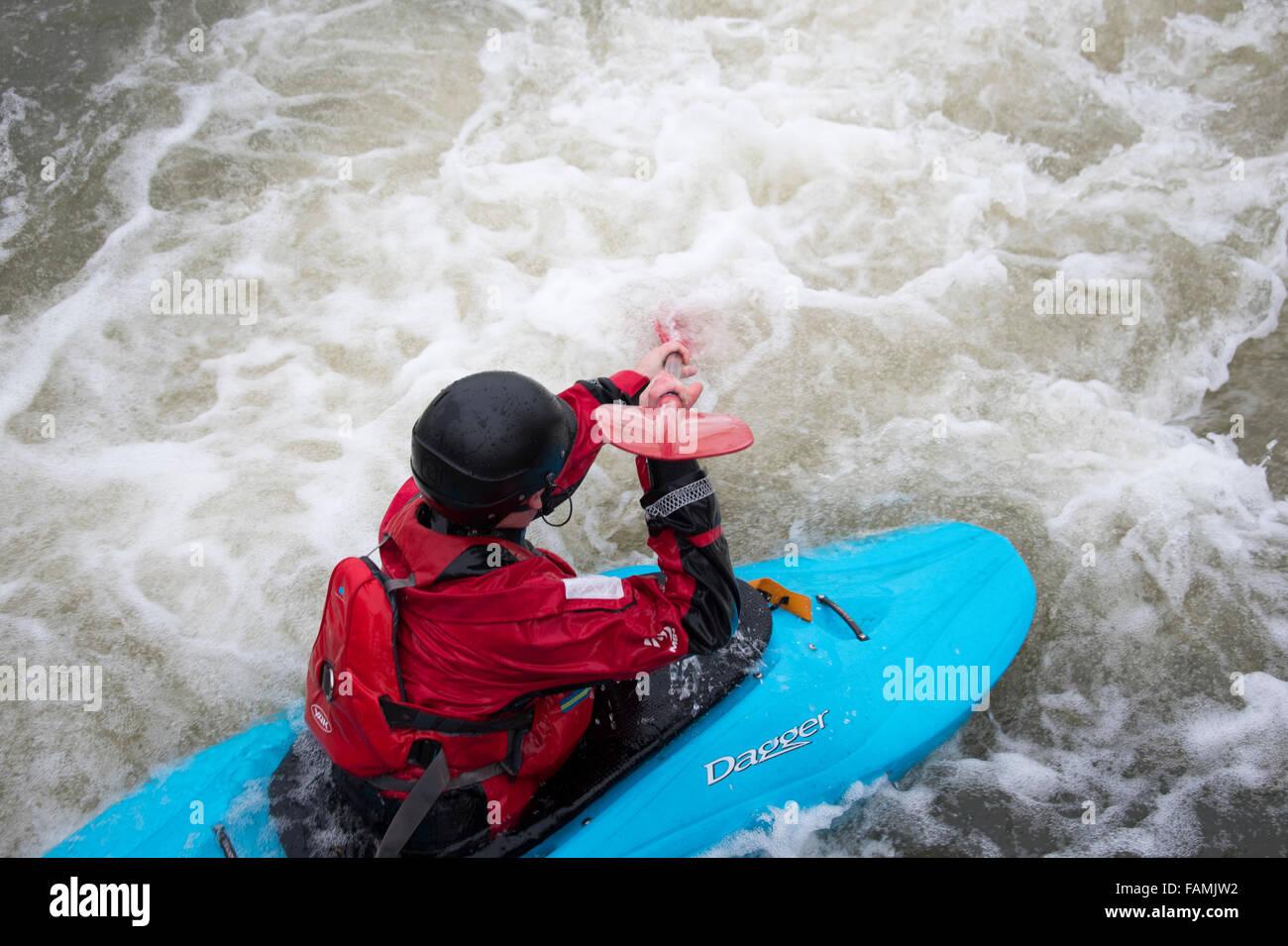Woman kayaking in fast water - Stock Image