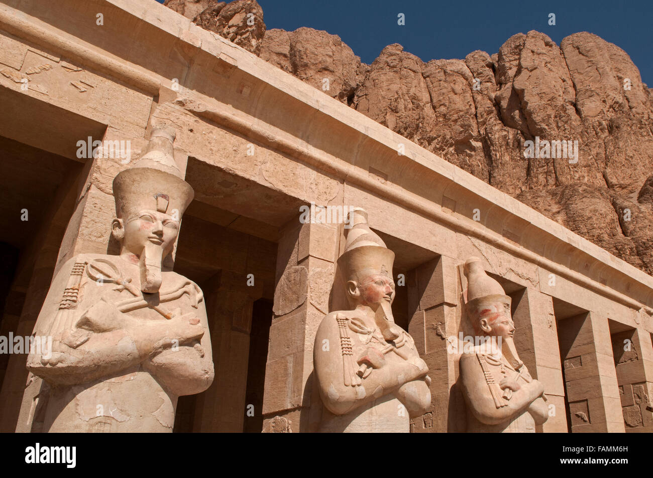 Osiride statues of the female Pharaoh at the entrance to the Mortuary Temple of Queen Hatshepsut, located in The - Stock Image