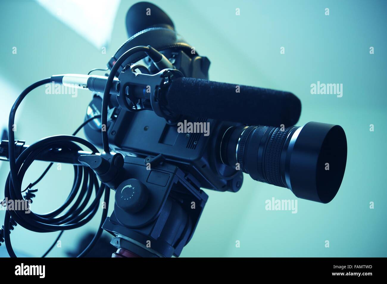 Interview Video Camera Setup. Modern Video Camera or Camcorder with Shotgun Microphone. Stock Photo