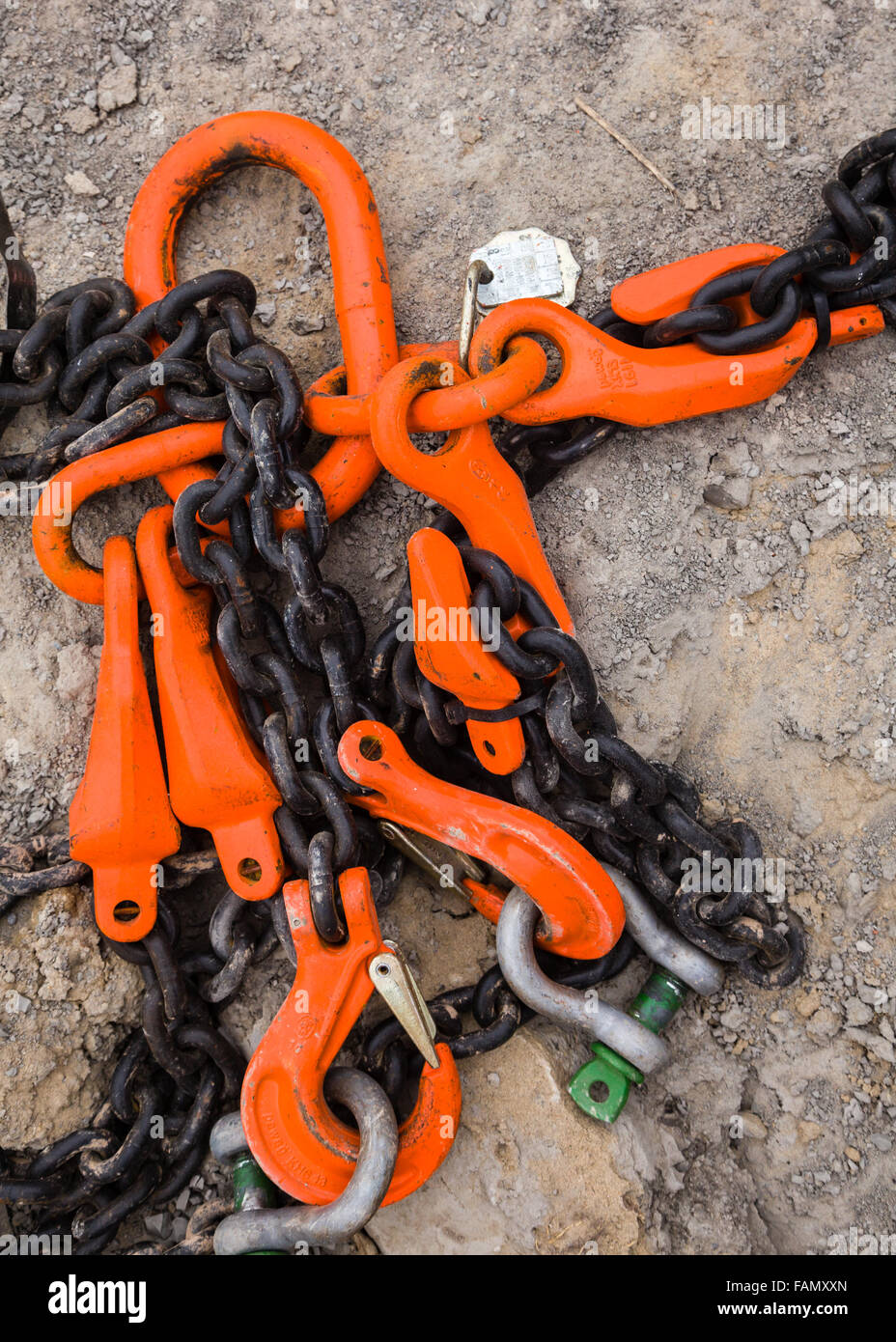Industrial chains and hooks on a construction site. - Stock Image